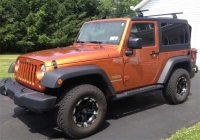 June 7, (Saturday), 2014 - Auction in East Syracuse with Unique Property for Sale!!   Great Items including a Jeep Wrangler, a Kubota, proffesional workout equipment, and wonderful newer home furnishings!